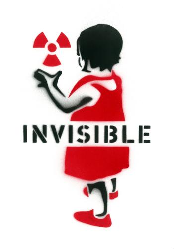 Toddler touching a radiation symbol