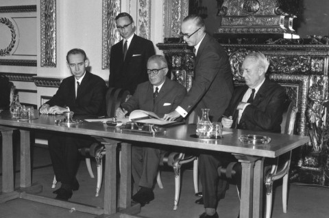 Britain's Foreign Secretary Michael Stewart signs the treaty on the Non-Proliferation of Nuclear Weapons at Lancaster House, London, with the Soviet Ambassador (left) and the US Ambassador (right) on July 1, 1968.