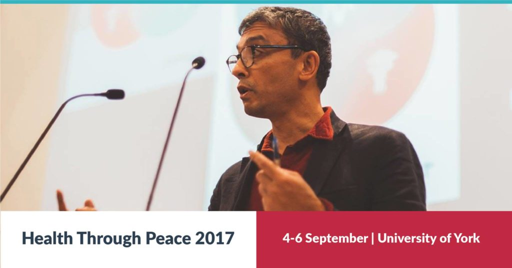 "Image of a man speaking into a microphone, and text that reads ""Health Through Peace 2017. 4 to 6 September. University of York"""