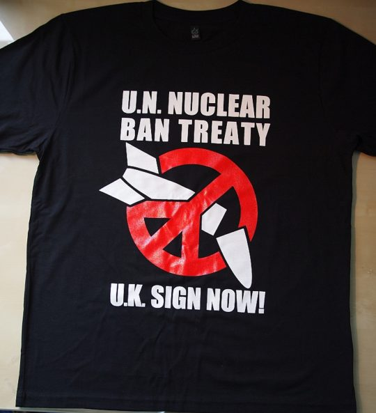 T-shirt with ICAN logo and text U.N Nuclear Ban Treaty, U.K Sign now!