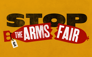 "Image says ""Stop the Arms Fair"" with a picture of a broken bomb with a price tag on it."