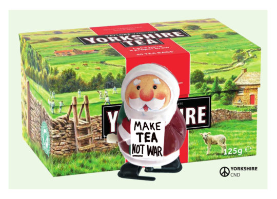 Yorkshire Tea box with Santa holding sign which reads 'Make Tea not War'